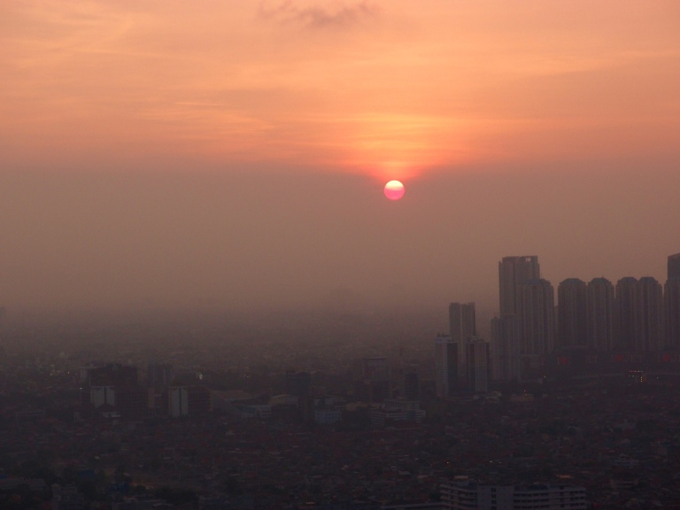 Air pollution in Jakarta, makes the sun appear like it is melting rather than setting.